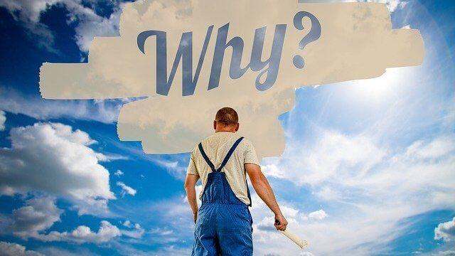 """空中に""""Why?""""を描く男性"""